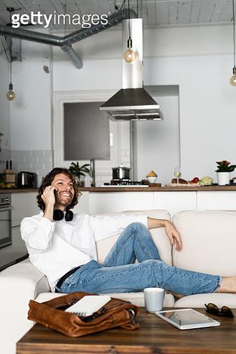 Businessman relaxing on the sofa in a modern loft - gettyimageskorea