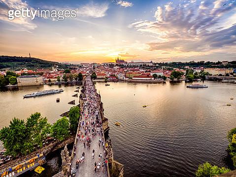 Charles Bridge full of tourists during sunset in Prague - gettyimageskorea