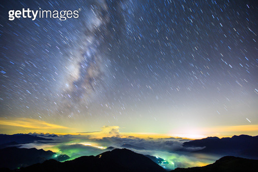 Milky way and star trails in night sky - gettyimageskorea