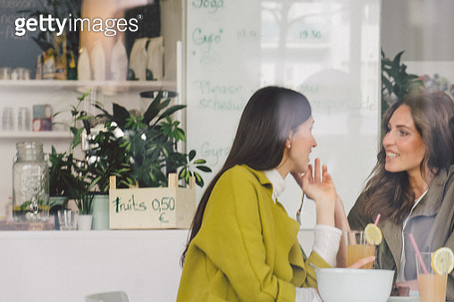 Beautiful women talking in cafe - gettyimageskorea