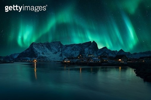 Scenic View Of Aurora Borealis Over Snowcapped Mountain - gettyimageskorea