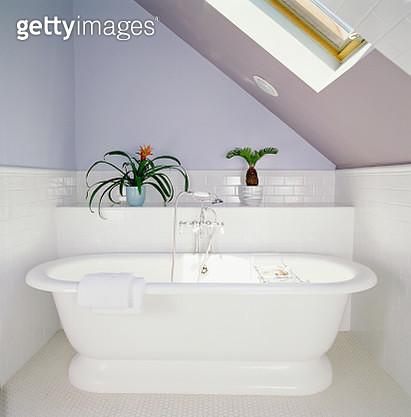 Bathtub under Skylight in Attic Bathroom - gettyimageskorea
