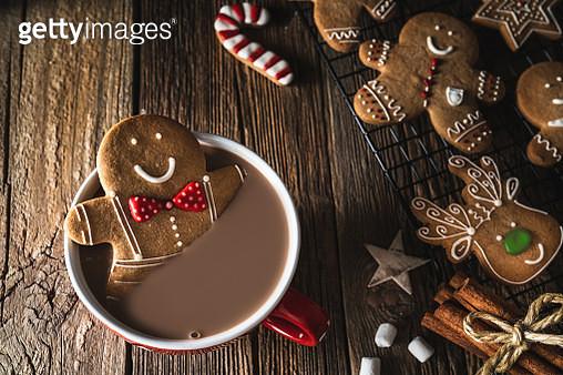 Gingerbread man Christmas cookie inside hot chocolate mug - gettyimageskorea