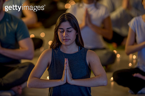 Prayer Pose In Yoga Studio - gettyimageskorea