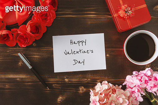 Happy Valentine's Day on White Paper over Rustic Wood Background - gettyimageskorea