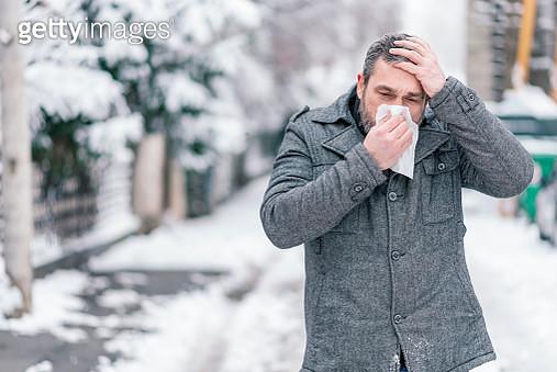Sick Man Blowing his Nose - gettyimageskorea