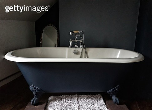 Close-Up Of Bathtub In Bathroom At Home - gettyimageskorea