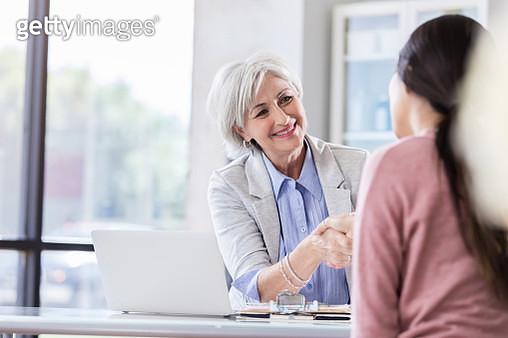 Mature businesswoman conducts job interview - gettyimageskorea