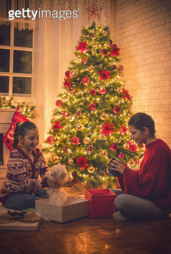 Family Opening a Christmas Presents at Home - gettyimageskorea