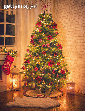 Christmas Tree Near Fireplace at Home - gettyimageskorea