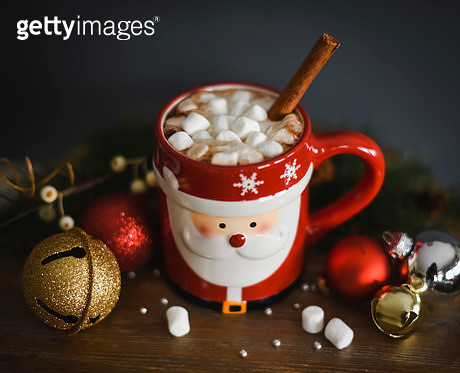 Hot cocoa in Santa mug with marshmallows and cinnamon stick. - gettyimageskorea