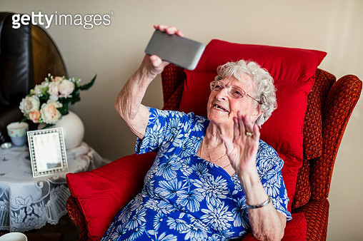 Elderly Woman Using A Mobile Telephone - gettyimageskorea