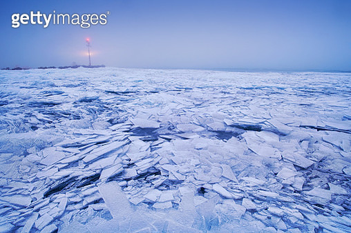 Scenic View Of Frozen Sea Against Sky During Winter - gettyimageskorea