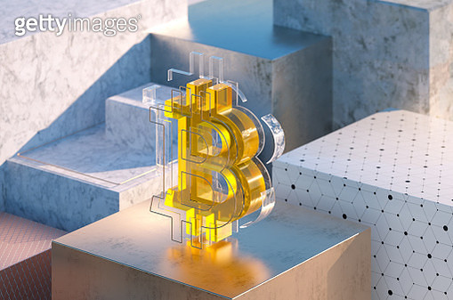 Close up 3d multilayered bitcoin sign standing on golden cube. - gettyimageskorea