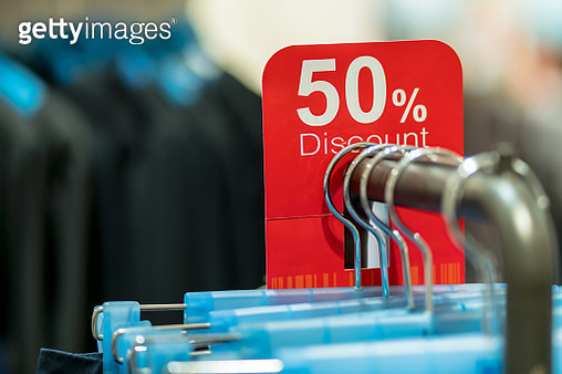 Business fashion and advertisement concept,Closeup sale 50% discount mock up advertise display frame setting over the clothes line in the shopping department store for shopping - gettyimageskorea