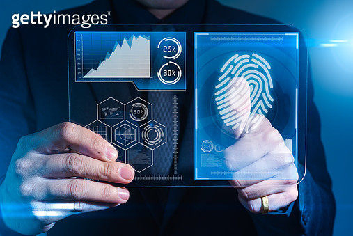 The abstract image of the businessman use a thumb scanning on futuristic tablet overlay with futuristic hologram. the concept of fingerprint, biometric, information technology and cyber security. - gettyimageskorea