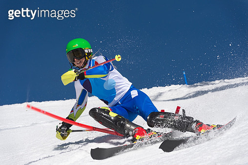 Front View of Young Female Skier at Slalom Ski Training - gettyimageskorea