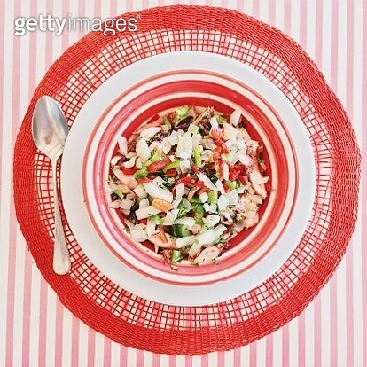 Directly above view of octopus salad in a red plate, Portugal - gettyimageskorea