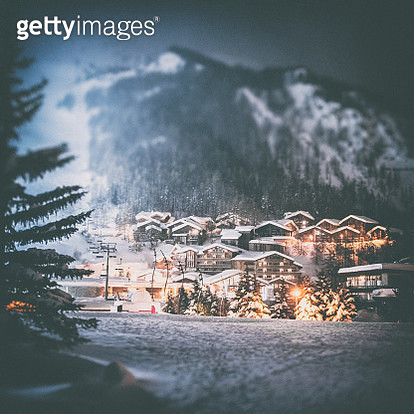 Color dark photography of Val d'isere ski resort illuminated village by snowy night in European Alps in winter, with some deep snow and ski lift equipements lost in fog. This image was taken in winter season in Val d'Isere, a french famous ski resort vill - gettyimageskorea