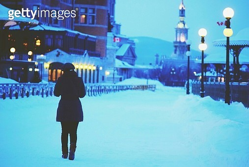 Rear Woman On Sidewalk At Dusk - gettyimageskorea