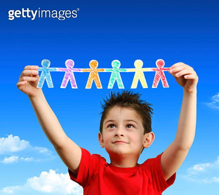 Little boy holding up paper men that he made. - gettyimageskorea