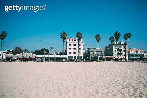 Beach Against Buildings In City Against Blue Sky - gettyimageskorea