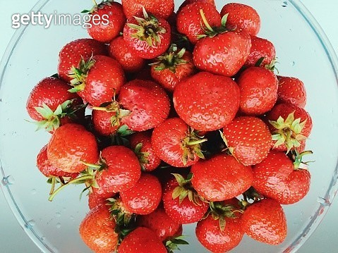 Close up of fresh strawberries in a plate - gettyimageskorea