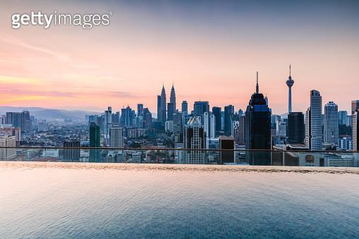 Infinity pool overlooking Kuala Lumpur skyline. Malaysia PROPERTY RELEASED - gettyimageskorea