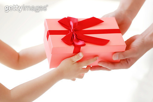 Close up of baby girl and mother holding gift box - gettyimageskorea