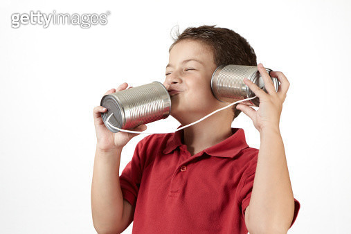 Child talking with a tin can phone - gettyimageskorea