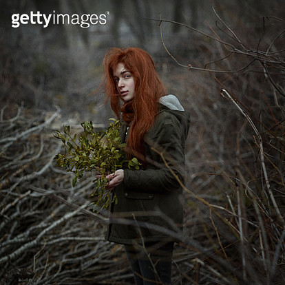 Portrait of a girl with red hair in a forest. - gettyimageskorea