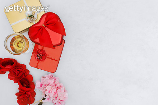 Overhead view of wine glass, gift boxes and flower on white background. - gettyimageskorea