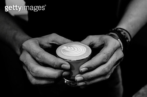 Midsection Of Man Having Coffee In Cup - gettyimageskorea