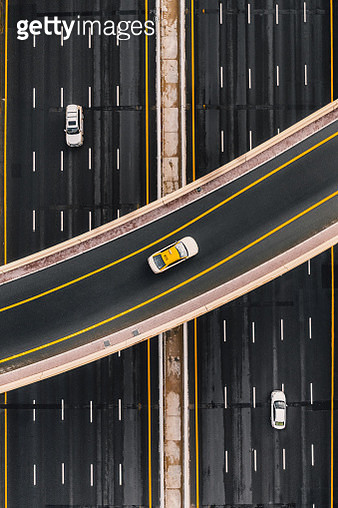 Taxi on an overpass crossing above a multilane highway, United Arab Emirates - gettyimageskorea