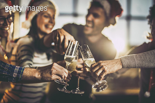 Close up of drinking champagne on New Year's party. - gettyimageskorea