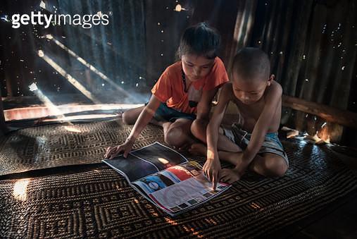 Children reading in Thailand. - gettyimageskorea