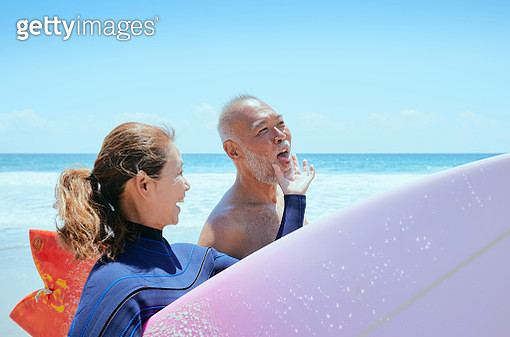 Active senior husband and wife love playing Surfing at Izu Peninsula UNESCO Global Geopark Japan - gettyimageskorea