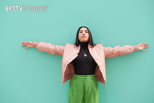 Young woman with arms outstretched. - gettyimageskorea