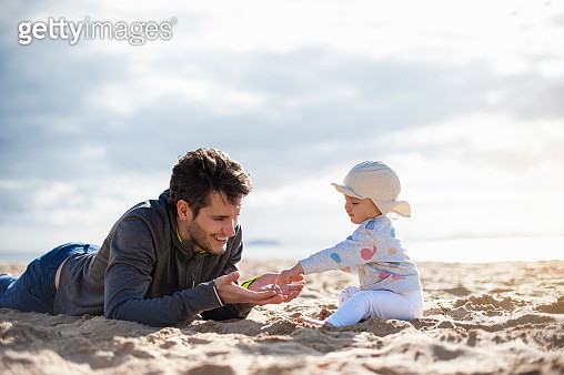 Spain, Lanzarote, father playing with baby girl on the beach - gettyimageskorea