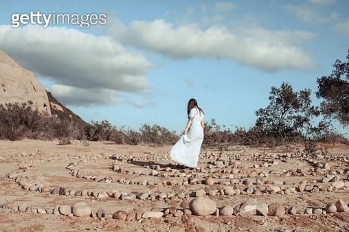 Woman Walking On Land Against Sky - gettyimageskorea
