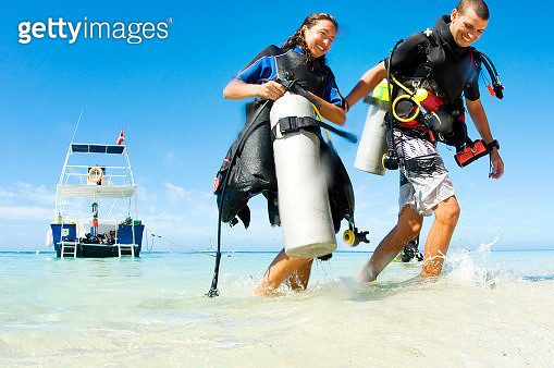 Scuba divers at the end of a dive - gettyimageskorea