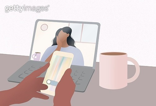 Talking with friend and searching at phone. Conference video call. Computer screen. Working from home. Home schooling at Computer. - gettyimageskorea