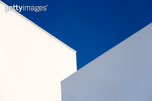 Walls of a white and pale blue buildings against a vibrant blue sky, Cadiz, Andalucia, Spain, Europe. - gettyimageskorea