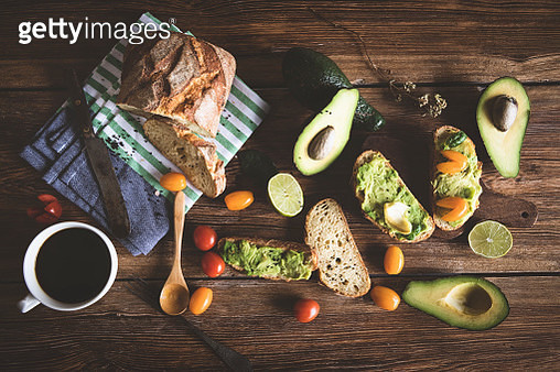 Sandwiches with avocado and tomato on a wooden background - gettyimageskorea