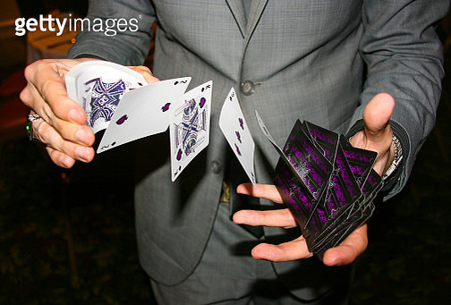 Magician shuffling cards in mid air - gettyimageskorea