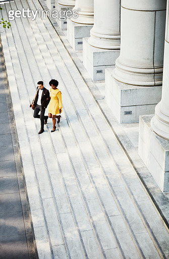 Overhead view of couple walking down steps of building - gettyimageskorea