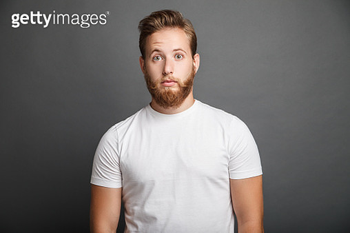 Surprised young man posing on gray - gettyimageskorea