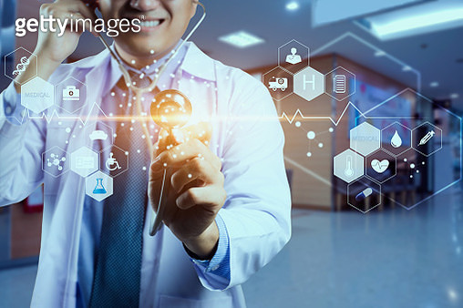 Medicine doctor and stethoscope in hand touching icon medical network connection with modern virtual screen interface, medical technology network concept - gettyimageskorea