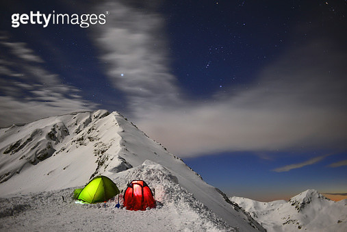 Nighttime tents in the snow - gettyimageskorea