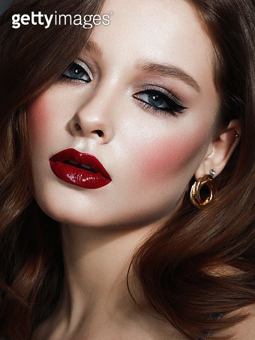 Portrait of beautiful woman with black eyeliner and bright lip gloss - gettyimageskorea